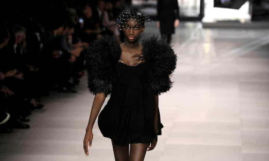 A model presents a creation by the designer Hedi Slimane as part of his spring-summer 2019 women's ready-to-wear collection show for the fashion house Celine.