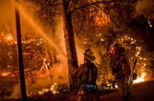 Firefighters hose the flames at Sheep Ranch