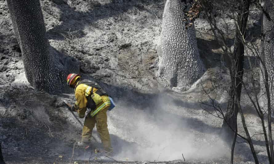 A firefighter checks for hot spots near Clearlake, California. wildfires