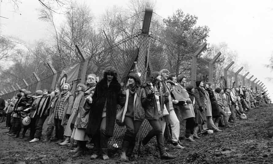 Women from the Greenham Common peace camp chain in 198