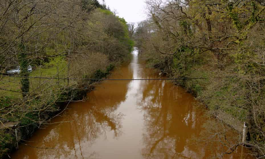 River Teign turns red due to pollution from a nearby quarry, Devon, England