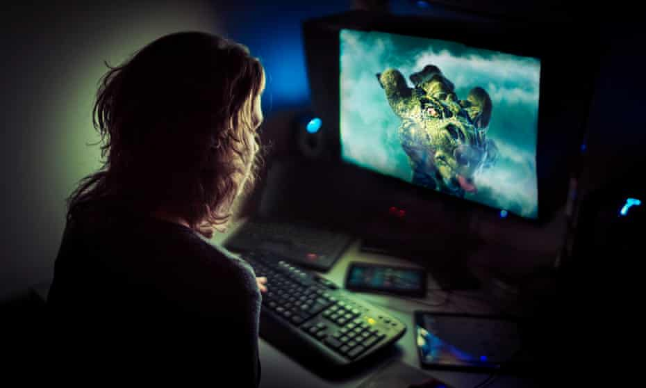 A computer gamer playing late at night.