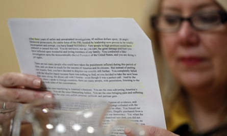 Representative Debbie Lesko reads a copy of Trump's letter on Capitol Hill in Washington Tuesday.