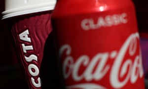 A Costa Coffee cup with a can of Coca-Cola