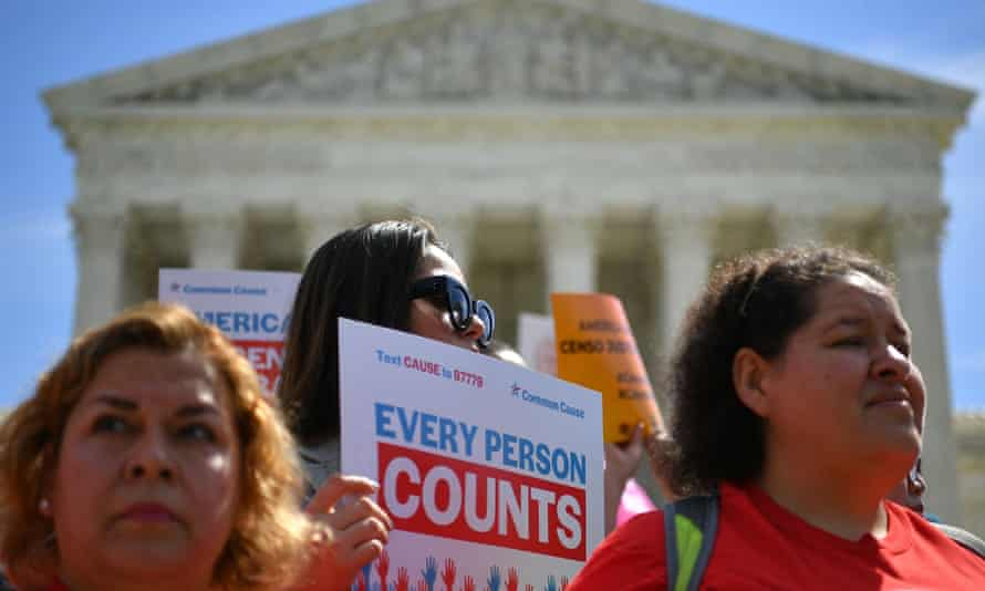 Demonstrators rally at the US supreme court in Washington DC, to protest a proposal to add a citizenship question in the 2020 census.