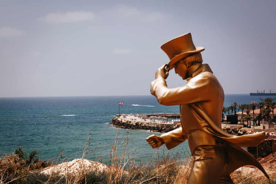 A gold Johnnie Walker promotional statue overlooks a sea-side resort on the outskirts of Batroun on 15 July, 2020.