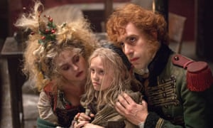 Baron Cohen with Helena Bonham Carter and Isabelle Allen in Les Misérables.