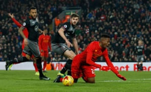 Origi goes down in the area after a challenge by Stephens.