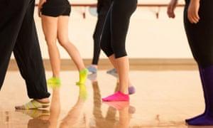 Teenage dancers standing in a dance studio