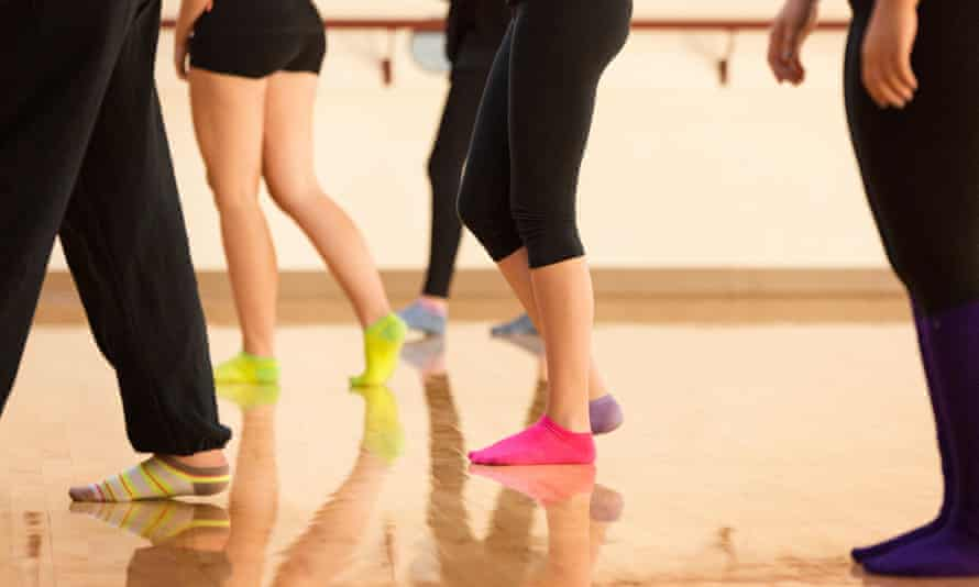 Teenage dancers standing in a dance studio
