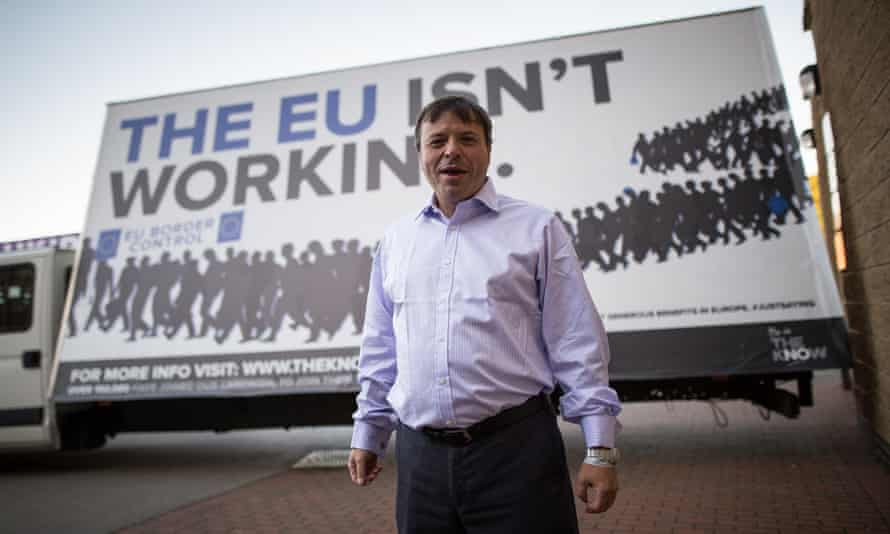 Aaron Banks in front of an anti-EU advert in 2015