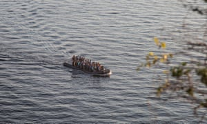 A rubber dinghy carrying approximately 45 people mostly from Afghanistan crossing the strait between Greece and Turkey, in Molyvos