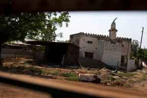 A mosque that has been destroyed is photographed through the frame of a destroyed vehicle in the town of Malakal, South Sudan Thursday, Dec. 8, 2016
