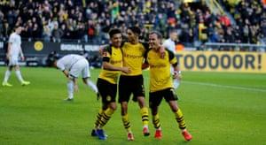 Jadon Sancho with Dortmund team-mates Mario Götze and Achraf Hakimi.