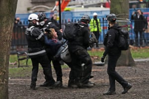 A protester is evicted from site