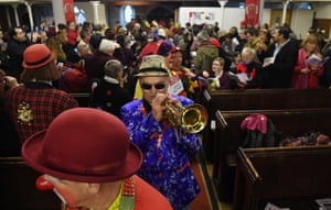 Clowns attend a service for Joseph Grimaldi at All Saints Church in east London, Britain