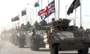 A convoy of British armoured vehicles patrol a road after pulling out from Basra Palace in September 2007.