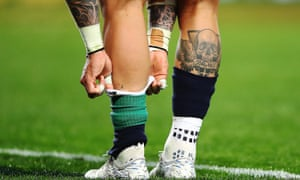 English rugby player Jack Nowell adjusts his socks during a match between Auckland Blues and the British & Irish Lions  in New Zealand in June 2017.