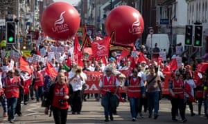 Honda workers march through Swindon with Unite union balloons and banners