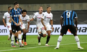 Romelu Lukaku (right) stands with his head bowed after deflecting a bicycle kick by Diego Carlos (second right) into Inter's net.