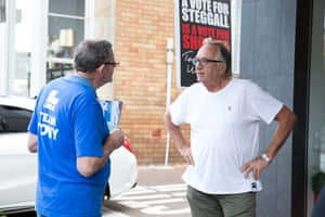 A Warringah resident disagrees with a Tony Abbott volunteer at a pre-poll booth in Mosman.