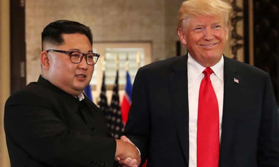 Donald Trump and Kim Jong-un shake hands after signing documents during their summit in Singapore in June.