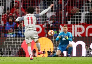 Neuer covers the shot from Salah.