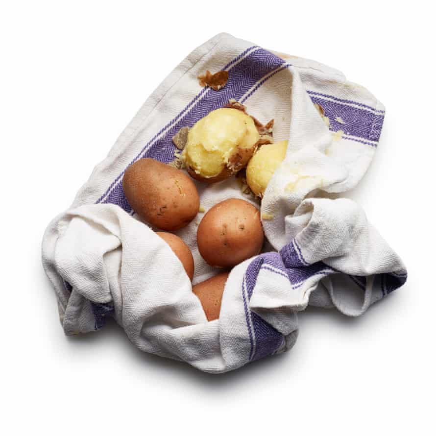 Felicity Cloake Aligot 031 Boil the unpeeled potatoes in salted water until cooked through. Drain, then rub in a tea towel to remove the skins