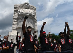 Demonstrators gather at the Martin Luther King Jr memorial in Washington DC, on 19 June.