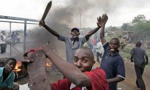 Kenyan men at a makeshift roadblock in Kisumu, 2008.