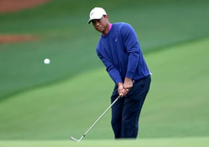 Tiger Woods plays a shot to the 14th green.