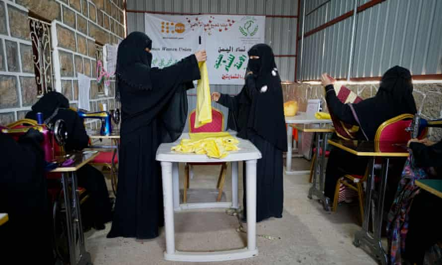 Women make clothes for victims of violence, at a support centre in Turba, north-west of Aden.