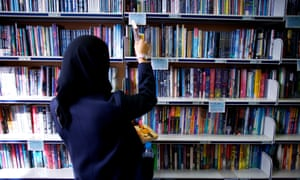 a pupil visiting a secondary school library.