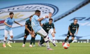 Riyad Mahrez tucks in the penalty.