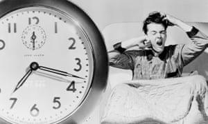 Man waking up to alarm clock