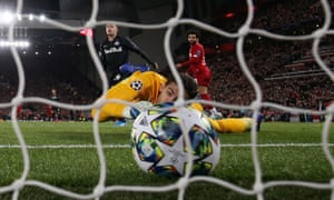 Liverpool's Mohamed Salah scores their third goal past FC Salzburg's Cican Stankovic.