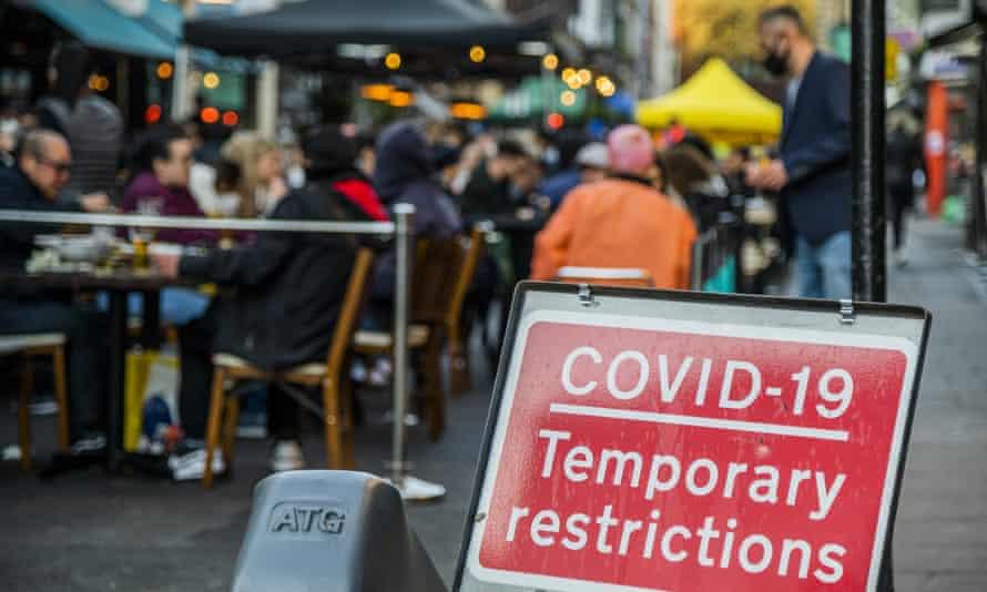 People enjoy outdoor drinking in London