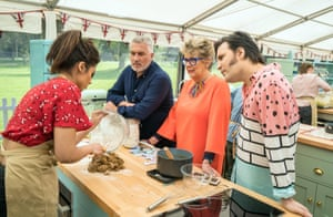 Ruby gets to grips with biscuit making with The Bake Off team.