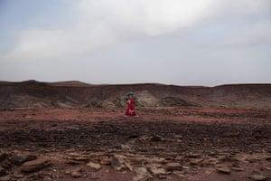 Umm Yasser guides tourists on a trek.