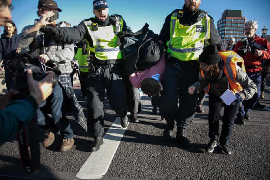 An activist is arrested during the November protests