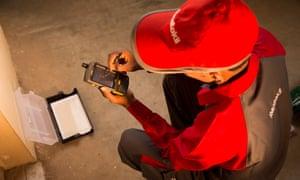Rentokil worker in a red cap
