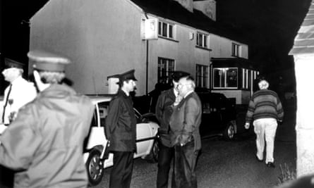 Police outside the Heights Bar, Loughinisland, in June 1994.