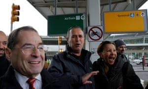 Iraqi immigrant Hameed Darweesh walks out of Terminal 4 at JFK with Congressman Jerrold Nadler (L) and Congresswoman Nydia Velazquez (R) after being released on Saturday.