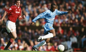 Peter Ndlovu, playing for Coventry City, outpaces the Manchester United defender Gary Pallister during a Premier League match at Old Trafford.