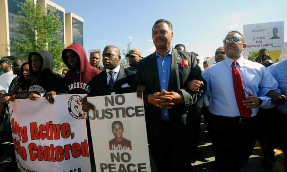 Jesse Jackson and others protest over the death of Trayvon Martin in 2012. More than three years later, the deaths of black Americans has been the topic of intense conversations.