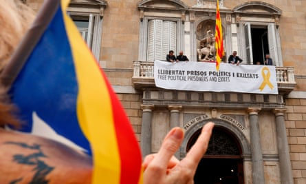 Catalan separatist banner hangs from the balcony of the Generalitat Palace in Barcelona.