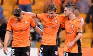 Brett Holman of Brisbane Roar is congratulated by teammates after scoring a goal in their 4-3 win over Wellington Phoenix.