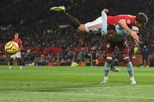 Manchester United's Harry Maguire ends up ontop of Aston Villa's Ezri Konsa as the teams draw 2-2 at Old Trafford.