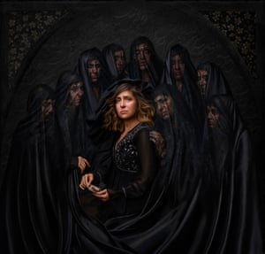 A woman surrounded by shrouded women
