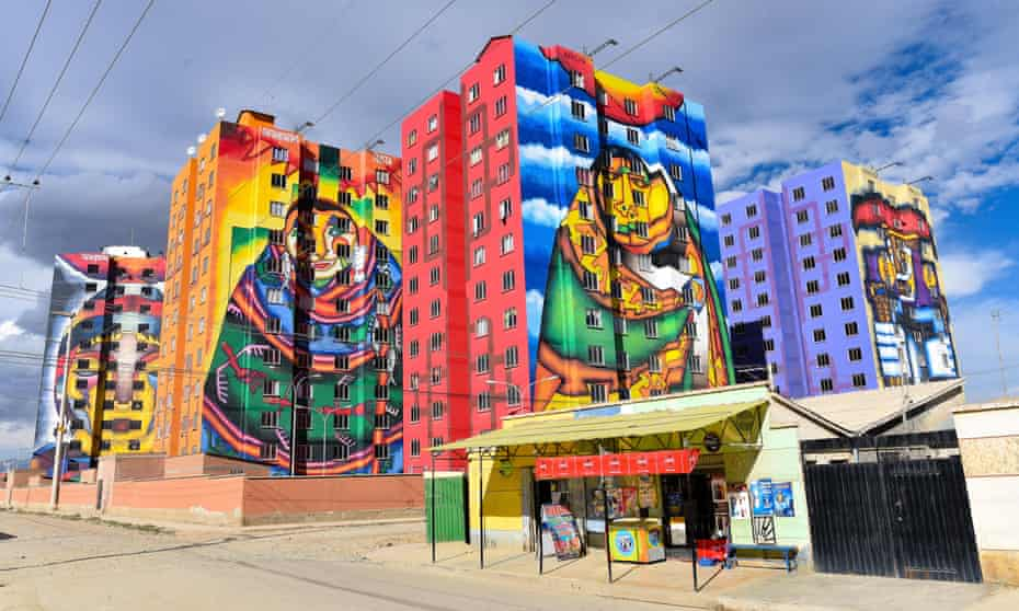 Brightly colored murals painted by Roberto Mamani (no relation) on apartment blocks in El Alto.